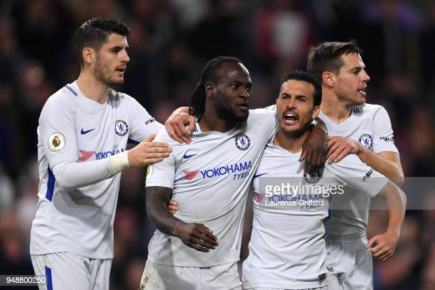 Victor Moses of Chelsea celebrates with teammates after scoring his sides second goal during the Premier League match between Burnley and Chelsea at...