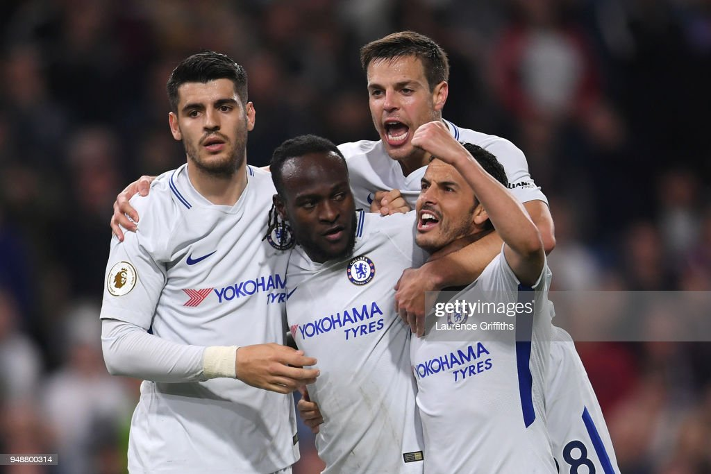 Victor Moses of Chelsea celebrates with teammates after scoring his sides second goal during the Premier League match between Burnley and Chelsea at Turf Moor on April 19, 2018 in Burnley, England.