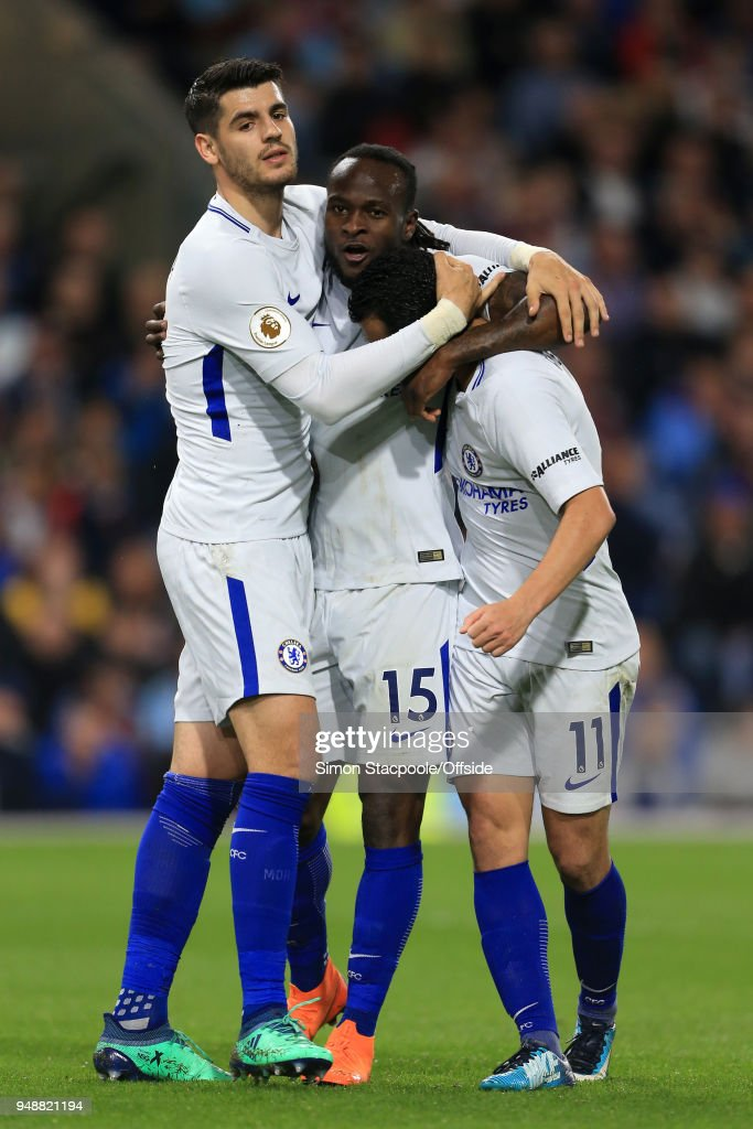 Victor Moses of Chelsea (C) celebrates with teammates Alvaro Morata (L) and Pedro (R) after scoring their 2nd goal during the Premier League match between Burnley and Chelsea at Turf Moor on April 19, 2018 in Burnley, England.