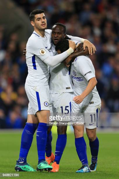 Victor Moses of Chelsea celebrates with teammates Alvaro Morata and Pedro after scoring their 2nd goal during the Premier League match between...