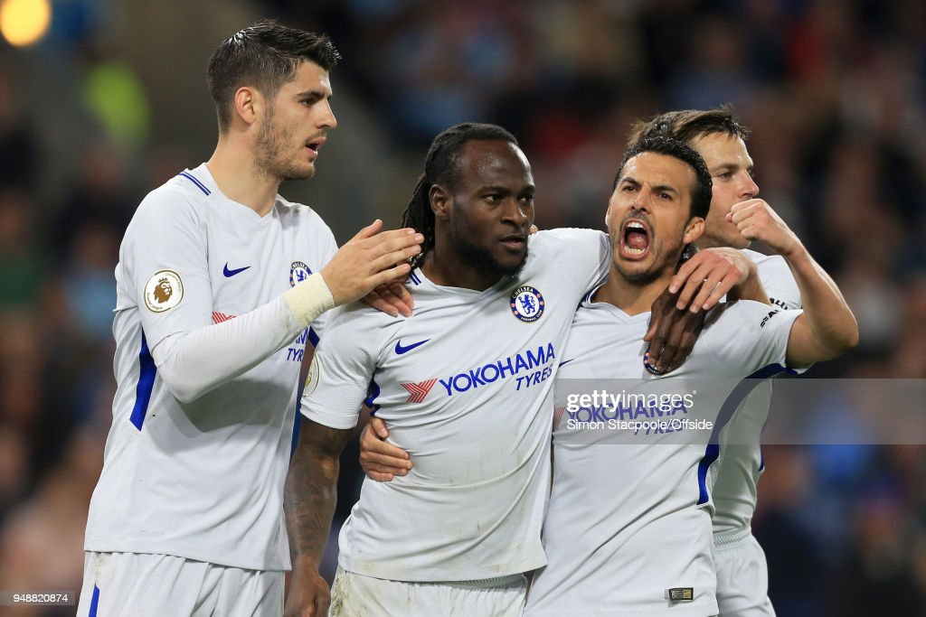 Victor Moses of Chelsea (2L) celebrates with teammates Alvaro Morata (L), Cesar Azpilicueta (R) and Pedro (2R) after scoring their 2nd goal during the Premier League match between Burnley and Chelsea at Turf Moor on April 19, 2018 in Burnley, England.