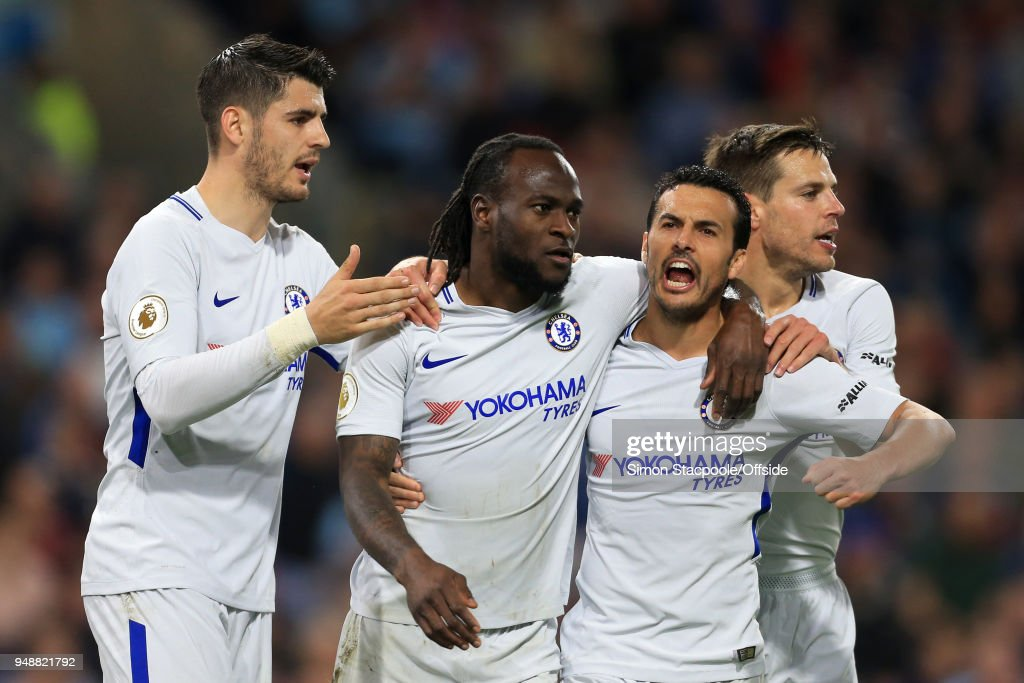 Victor Moses of Chelsea (2L) celebrates with teammates Alvaro Morata (L), Pedro (2R) and Cesar Azpilicueta (R) after scoring their 2nd goal during the Premier League match between Burnley and Chelsea at Turf Moor on April 19, 2018 in Burnley, England.
