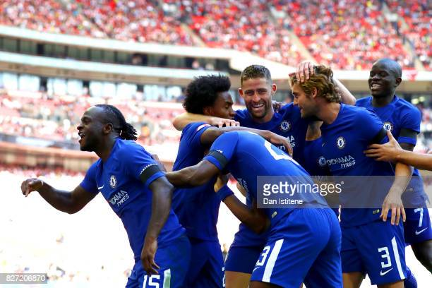 Victor Moses of Chelsea celebrates with teammates including Gary Cahill after scoring the opening goal during the FA Community Shield match between...