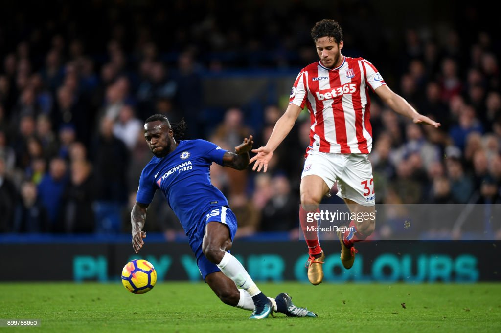 Victor Moses of Chelsea challenges Ramadan Sobhi of Stoke City during the Premier League match between Chelsea and Stoke City at Stamford Bridge on December 30, 2017 in London, England.