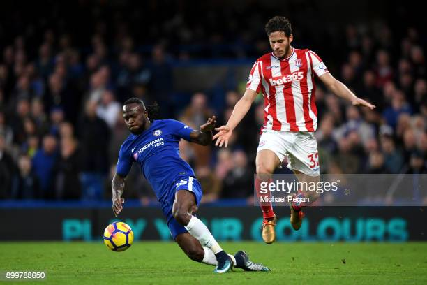 Victor Moses of Chelsea challenges Ramadan Sobhi of Stoke City during the Premier League match between Chelsea and Stoke City at Stamford Bridge on...