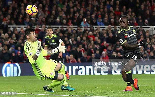 Victor Moses of Chelsea has a shot saved by Victor Valdes of Middlesbrough during the Premier League match between Middlesbrough and Chelsea at...