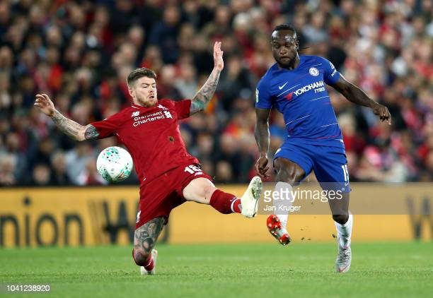 Victor Moses of Chelsea is challenged by Alberto Moreno of Liverpool during the Carabao Cup Third Round match between Liverpool and Chelsea at...