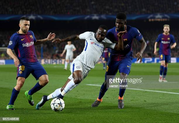Victor Moses of Chelsea is challenged by Samuel Umtiti of Barcelona during the UEFA Champions League Round of 16 Second Leg match FC Barcelona and...