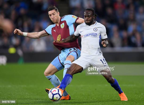 Victor Moses of Chelsea is challenged by Stephen Ward of Burnley during the Premier League match between Burnley and Chelsea at Turf Moor on April 19...
