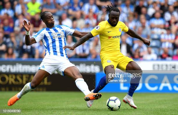 Victor Moses of Chelsea is challenged by Terence Kongolo of Huddersfield Town during the Premier League match between Huddersfield Town and Chelsea...