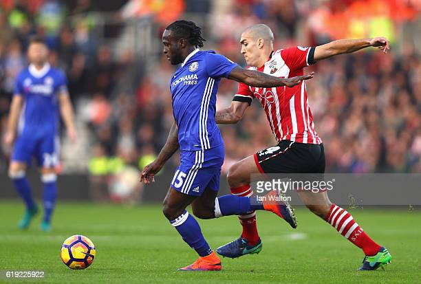 Victor Moses of Chelsea is chased down by Oriol Romeu of Southampton during the Premier League match between Southampton and Chelsea at St Mary's...
