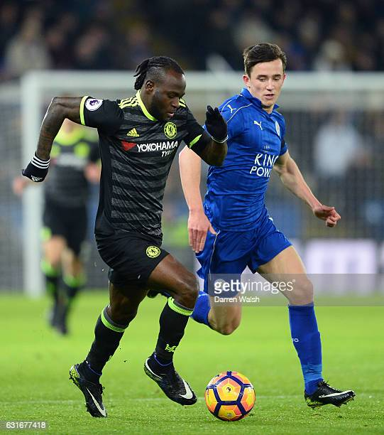 Victor Moses of Chelsea is closeddown by Ben Chilwell of Leicester City during the Premier League match between Leicester City and Chelsea at The...