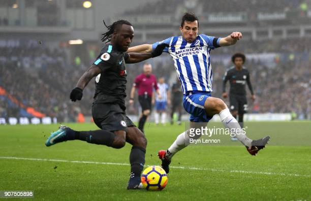 Victor Moses of Chelsea is faced by Markus Suttner of Brighton and Hove Albion during the Premier League match between Brighton and Hove Albion and...