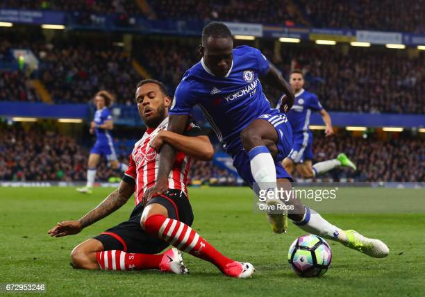 Victor Moses of Chelsea is tackled by Ryan Bertrand of Southampton during the Premier League match between Chelsea and Southampton at Stamford Bridge...