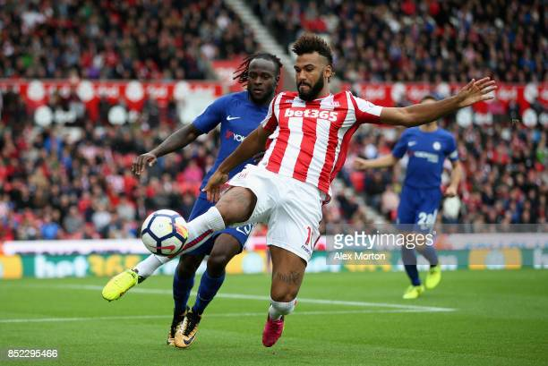 Victor Moses of Chelsea puts pressure on Maxim ChoupoMoting of Stoke City during the Premier League match between Stoke City and Chelsea at Bet365...