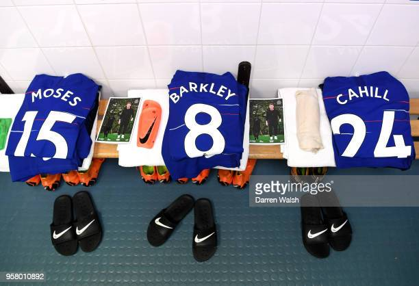 Victor Moses of Chelsea Ross Barkley of Chelsea and Gary Cahill of Chelsea shirts are seen inside the dressing room prior to the Premier League match...