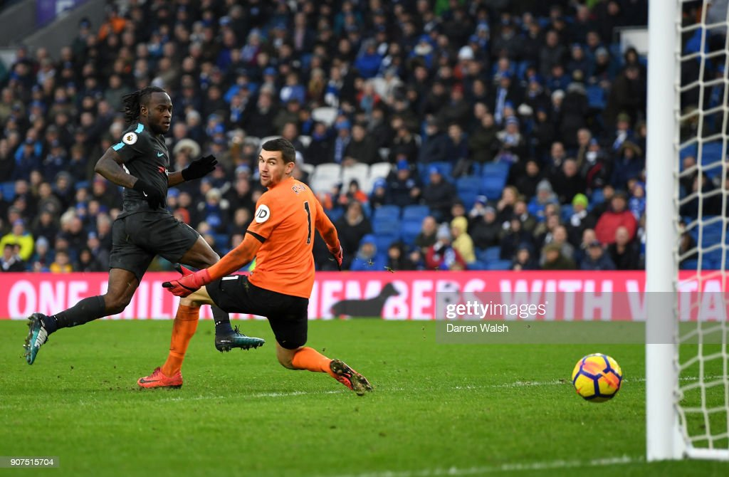 Victor Moses of Chelsea scores his side's fourth goal during the Premier League match between Brighton and Hove Albion and Chelsea at Amex Stadium on January 20, 2018 in Brighton, England.