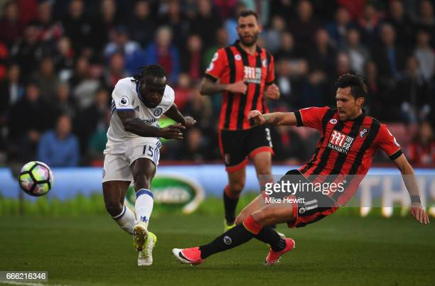 Victor Moses of Chelsea shoots as Charlie Daniels of AFC Bournemouth attempts to block during the Premier League match between AFC Bournemouth and...