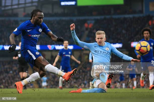 Victor Moses of Chelsea shoots past Oleksandr Zinchenko of Man City during the Premier League match between Manchester City and Chelsea at the Etihad...