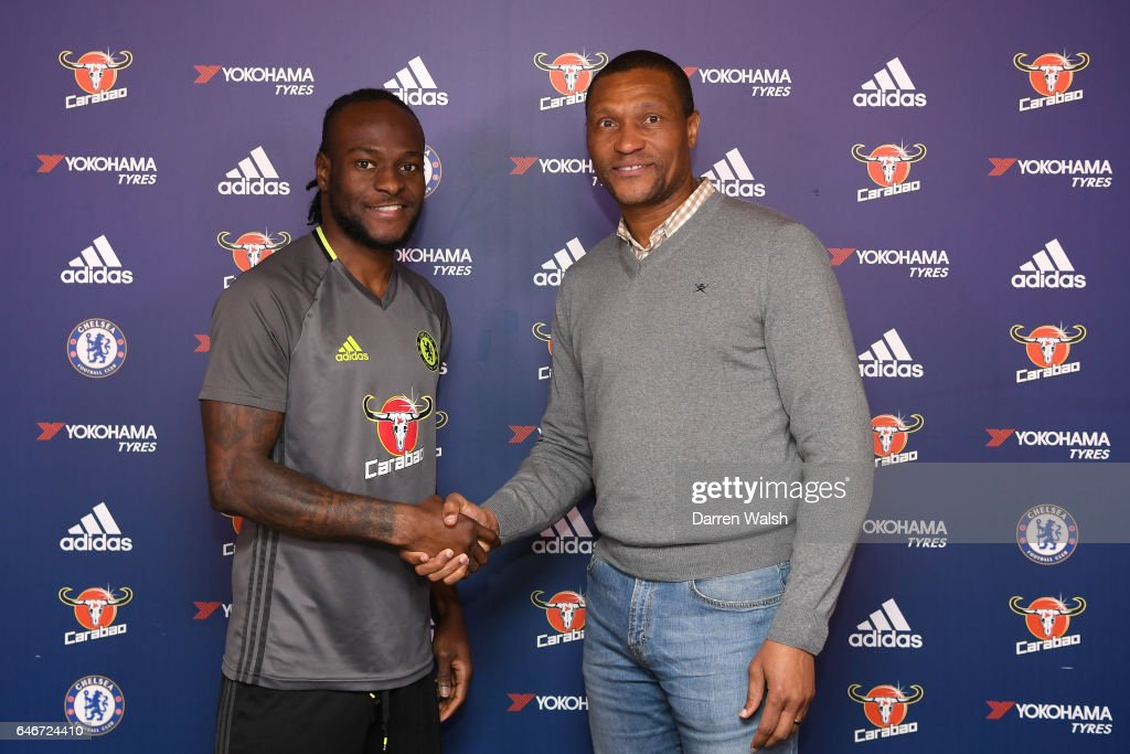 Victor Moses of Chelsea signs a new contract at Chelsea FC with Technical Director Michael Emenalo at Chelsea Training Ground on March 1, 2017 in Cobham, England.