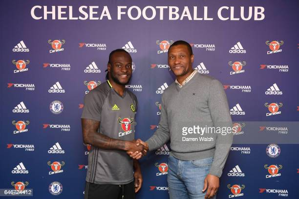 Victor Moses of Chelsea signs a new contract at Chelsea FC with Technical Director Michael Emenalo at Chelsea Training Ground on March 1 2017 in...