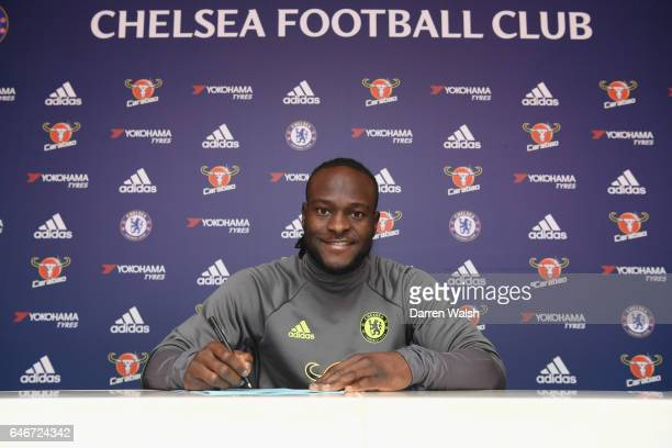 Victor Moses of Chelsea signs a new contract at Chelsea Training Ground on March 1, 2017 in Cobham, England.