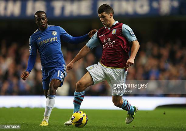 Victor Moses of Chelsea watches Eric Lichaj of Aston Villa during the Barclays Premier League match between Chelsea and Aston Villa at Stamford...