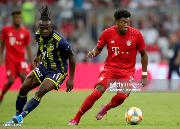 Victor Moses of Fenerbahce and David Alaba of FC Bayern Muenchen fight for the ball during the Audi cup 2019 semi final match between FC Bayern...