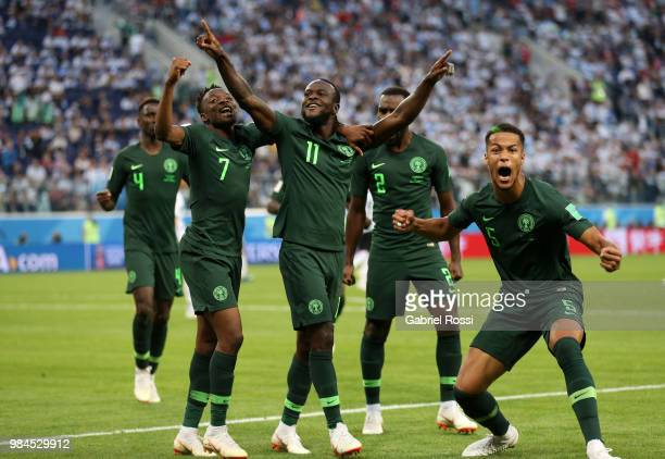 Victor Moses of Nigeria celebrates with teammates after scoring his team's first goal during the 2018 FIFA World Cup Russia group D match between...