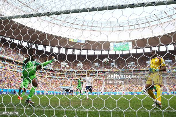 Victor Moses of Nigeria clears the ball off the goal line from a shot by Karim Benzema of France as goalkeeper Vincent Enyeama looks on during the...