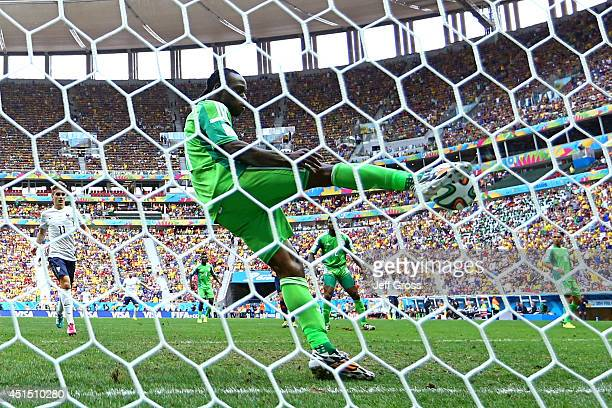 Victor Moses of Nigeria clears the ball off the goal line from a shot by Karim Benzema of France during the 2014 FIFA World Cup Brazil Round of 16...