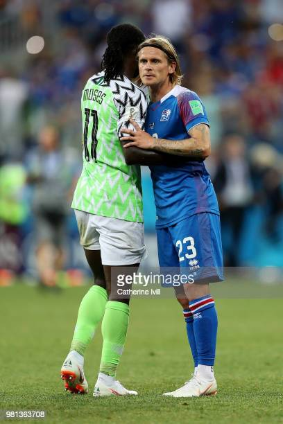 Victor Moses of Nigeria consoles Ari Skulason of Iceland following Iceland's defeat in the 2018 FIFA World Cup Russia group D match between Nigeria...