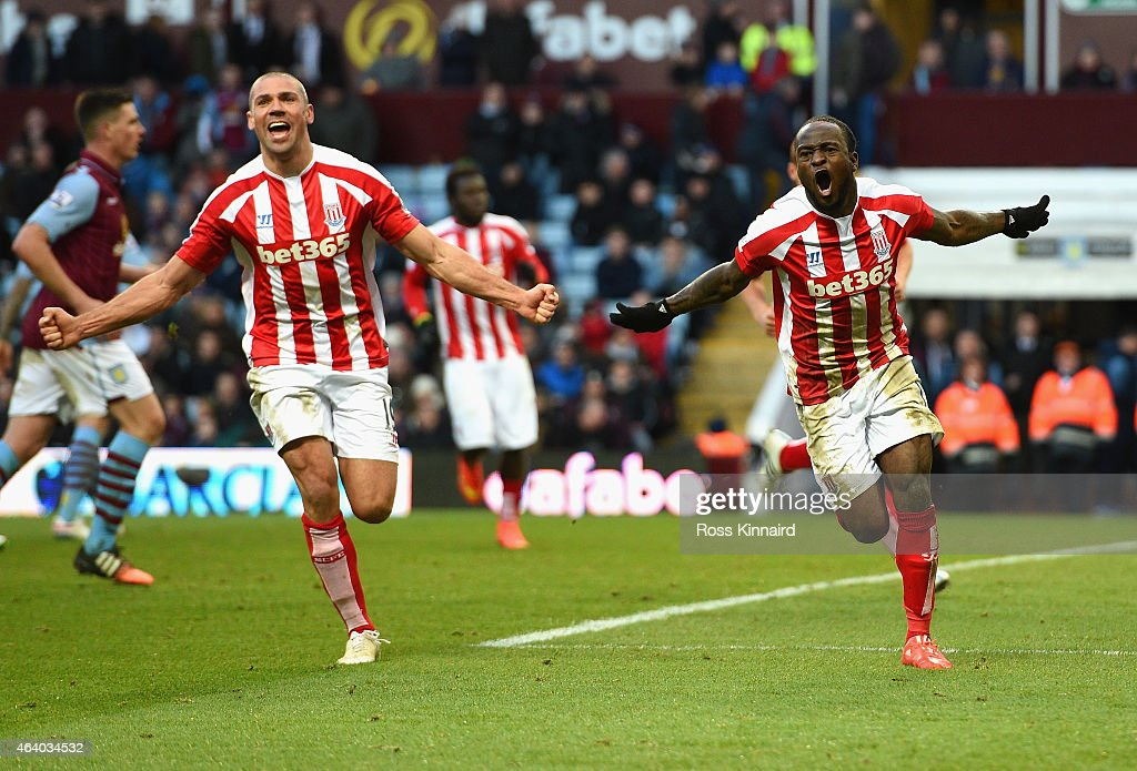 Victor Moses of Stoke City (R) celebrates scoring their second goal with Jonathan Walters of Stoke City (L) during the Barclays Premier League match between Aston Villa and Stoke City at Villa Park on February 21, 2015 in Birmingham, England.