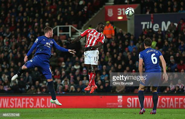 Victor Moses of Stoke City scores the first goal during the Barclays Premier League match between Stoke City and Everton at Britannia Stadium on...
