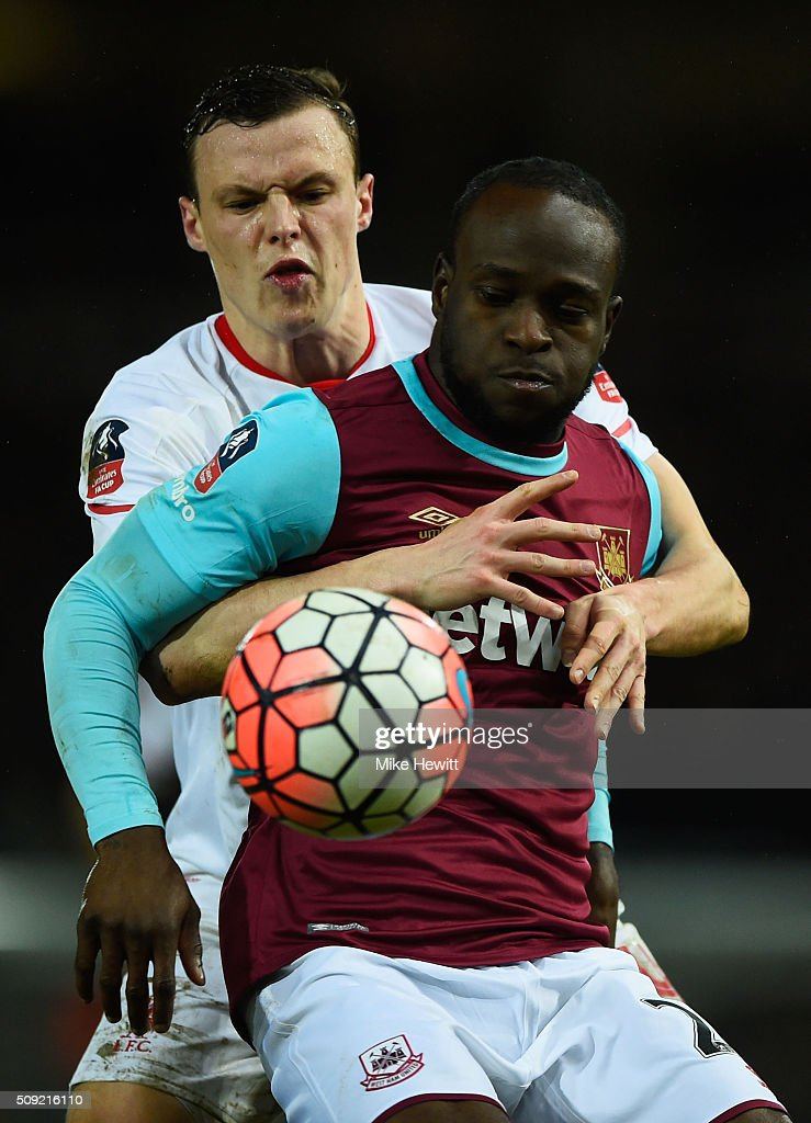 Victor Moses of West Ham United battles with Brad Smith of Liverpool during the Emirates FA Cup Fourth Round Replay match between West Ham United and Liverpool at Boleyn Ground on February 9, 2016 in London, England.