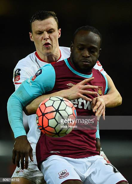Victor Moses of West Ham United battles with Brad Smith of Liverpool during the Emirates FA Cup Fourth Round Replay match between West Ham United and...