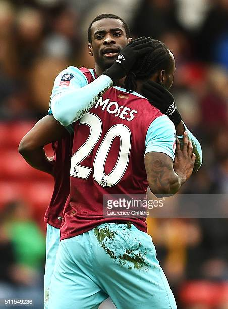 Victor Moses of West Ham United is congratulated by teammate Pedro Mba Obiang after scoring a goal to level the scores at 1-1 during The Emirates FA...
