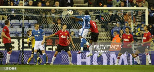 Victor Moses of Wigan Athletic heads the ball into the net only to have the goal ruled out for a Gary Caldwell foul on David de Gea of Manchester...