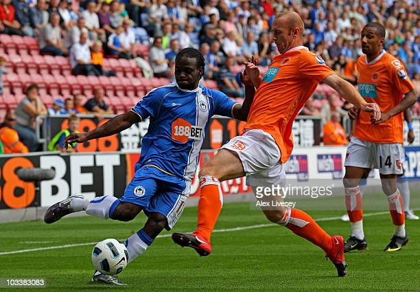 Victor Moses of Wigan Athletic is challenged by Stephen Crainey of Blackpool during the Barclays Premier League match between Wigan Athletic and...
