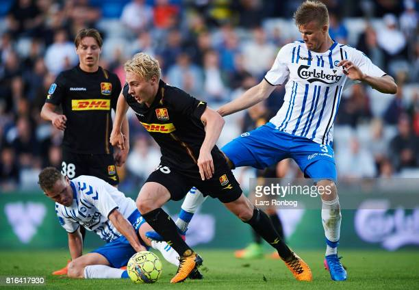 Victor Nelsson of FC Nordsjalland and Frederik Tingager of OB Odense compete for the ball during the Danish Alka Superliga match between OB Odense...