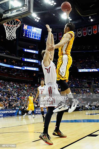 E Victor Nickerson of the Valparaiso Crusaders makes a shot over Jake Layman of the Maryland Terrapins during the second round of the Men's NCAA...
