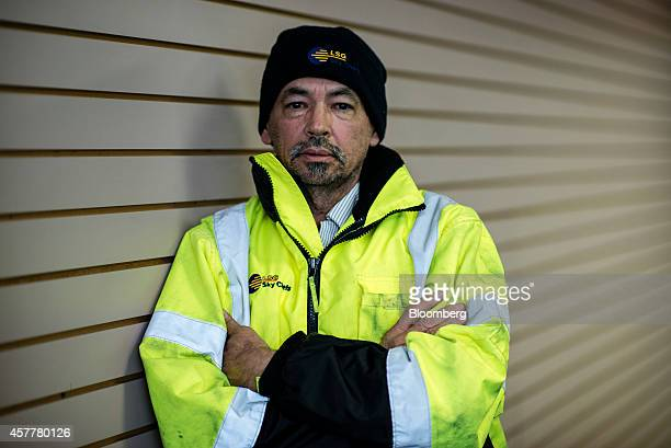 Victor Nunez a worker with LSG Sky Chefs stands for a photograph in the Queens borough of New York US on Tuesday Oct 21 2014 Nunez is a truck driver...