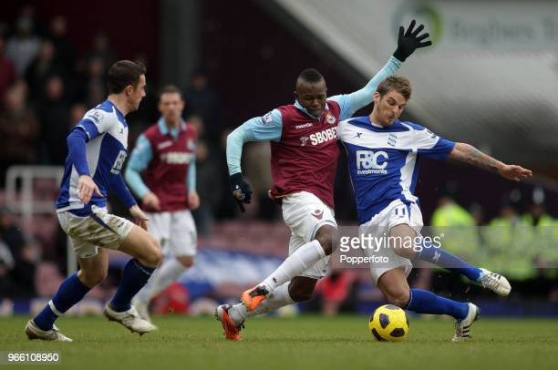 Victor Obinna of West Ham is challenged by David Bentley and Barry Ferguson of Birmingham City during the Barclays Premier League match between West...