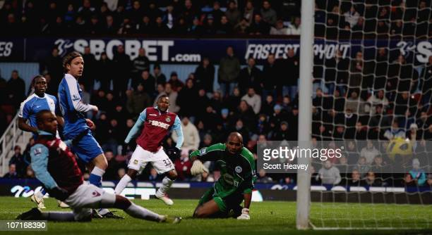 Victor Obinna of West Ham scores their second goal during the Barclays Premier League match between West Ham United and Wigan Athletic at Boleyn...