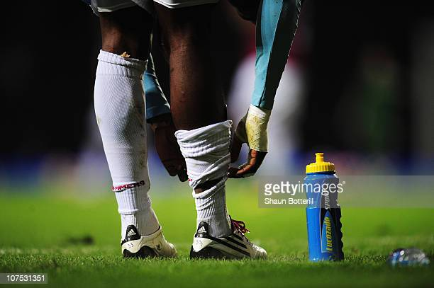 Victor Obinna of West Ham United adjusts his socks on the touchline during the Barclays Premier League match between West Ham United and Manchester...