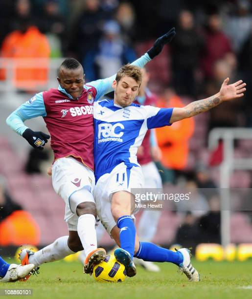 Victor Obinna of West Ham United and David Bentley of Birmingham City battle for the ball during the Barclays Premier League match between West Ham...