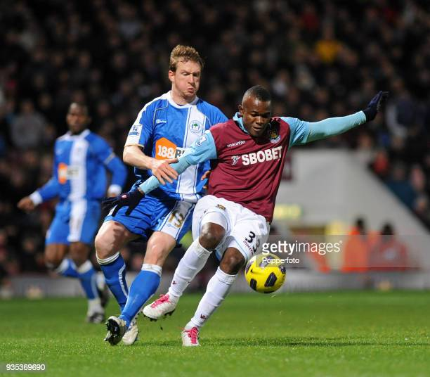 Victor Obinna of West Ham United and Steven Caldwell of Wigan Athletic in action during the Barclays Premier League match between West Ham United and...