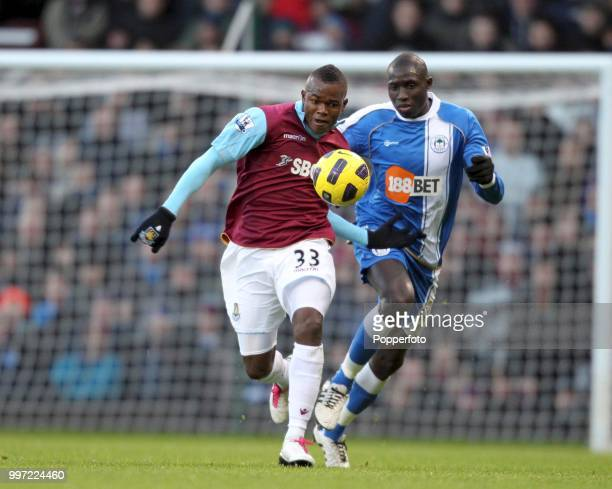 Victor Obinna of West Ham United is chased by Mohamed Diame of Wigan Athletic during a Barclays Premier League match at Upton Park on November 27...