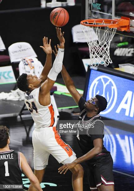 Victor Ohia Obioha of the Pepperdine Waves is fouled by Jaden Bediako of the Santa Clara Broncos during the West Coast Conference basketball...