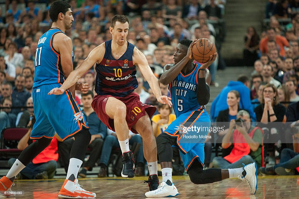 Victor Oladipo, #5 of Oklahoma City Thunder competes with Victor Claver, #10 of FC Barcelona Lassa during the NBA Global Games Spain 2016 FC Barcelona Lassa v Oklahoma City Thunder at Palau Sant Jordi on October 5, 2016 in Barcelona, Spain.